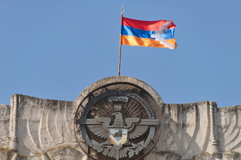 The coat of arms and the national flag of Nagorno Karabakh Republic