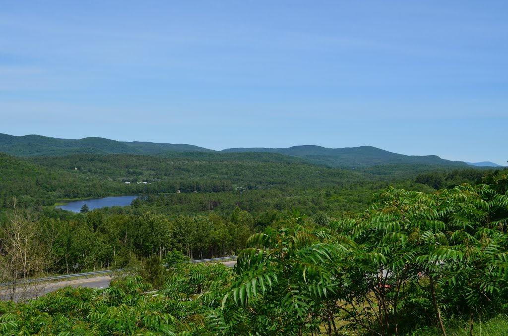 D9. Looking NNW L-R: Stocker Pond (1 mile), Sargent Hill (beyond pond) (1778') 5 miles, Prospect Hill in Enfield NH (Most rounded close mtn on R) (2118') 7 miles, Holts ledge (Dartmouth Skiway) (2110') 22 miles