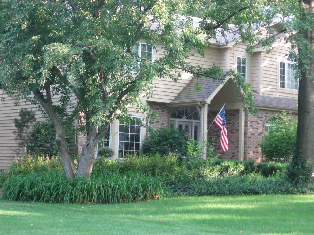 Nice House With American Flag Hanging Outside Mapio