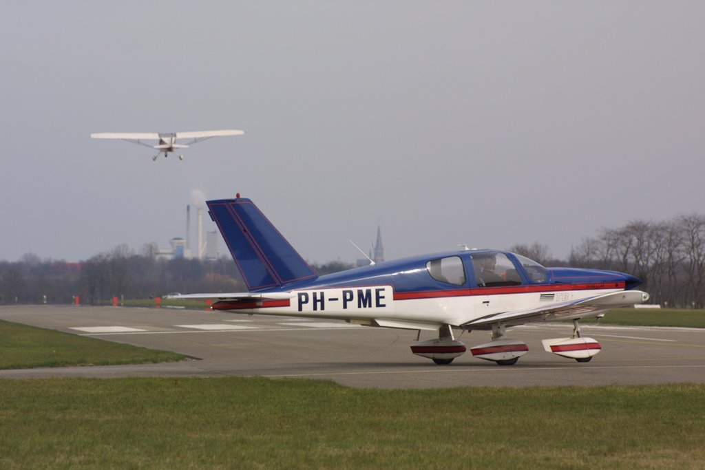 TB-10 plane holding short of the runway at Seppe