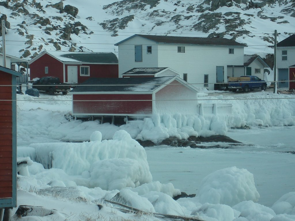Winter photo of a fishing stage covered with frozen sea spray.