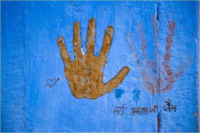 Blood hand print on blue wall