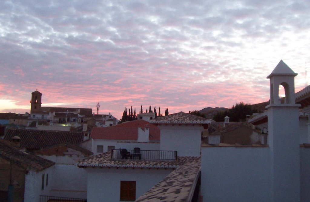 Sunset and Diezma church over the rooftops from our rental house Casa Molina