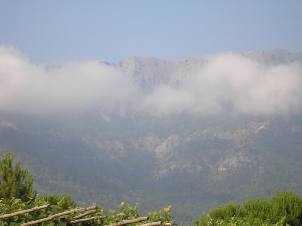 Clouds, montains near the sea