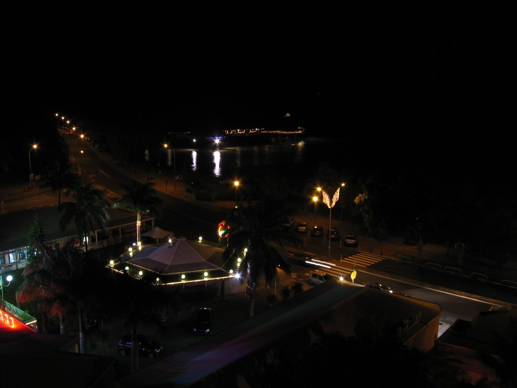 Night scene over shops and café towards restaurants on pier