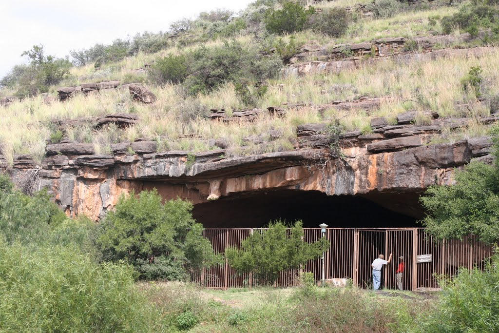 Wonderwerk Cave entrance with archaeologist Peter Beaumont