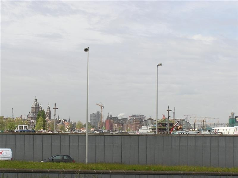 View of Amsterdam (from left St. Nicholas Church, Chinese restaurant, Railway station)