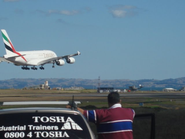 EK 412 lands from DBX and SYD
