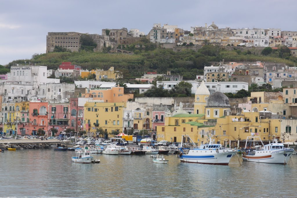 Procida - Marina di Procida with the Terra Murata in the background from the coming ferryboat