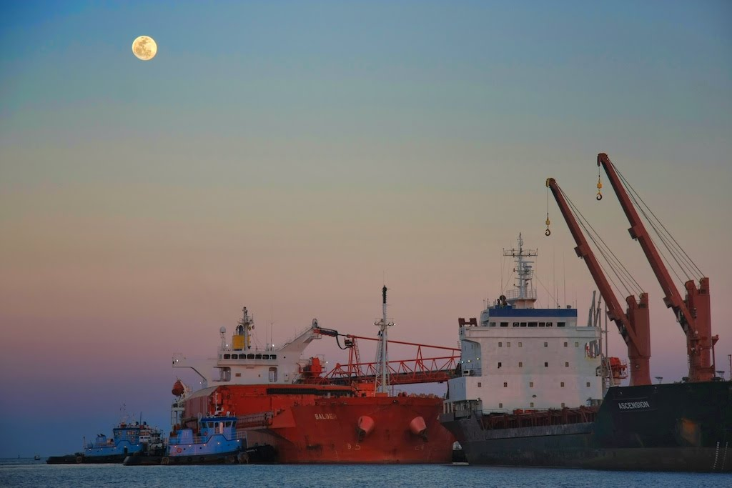 Port Canaveral Tugs pushing in the moonlight