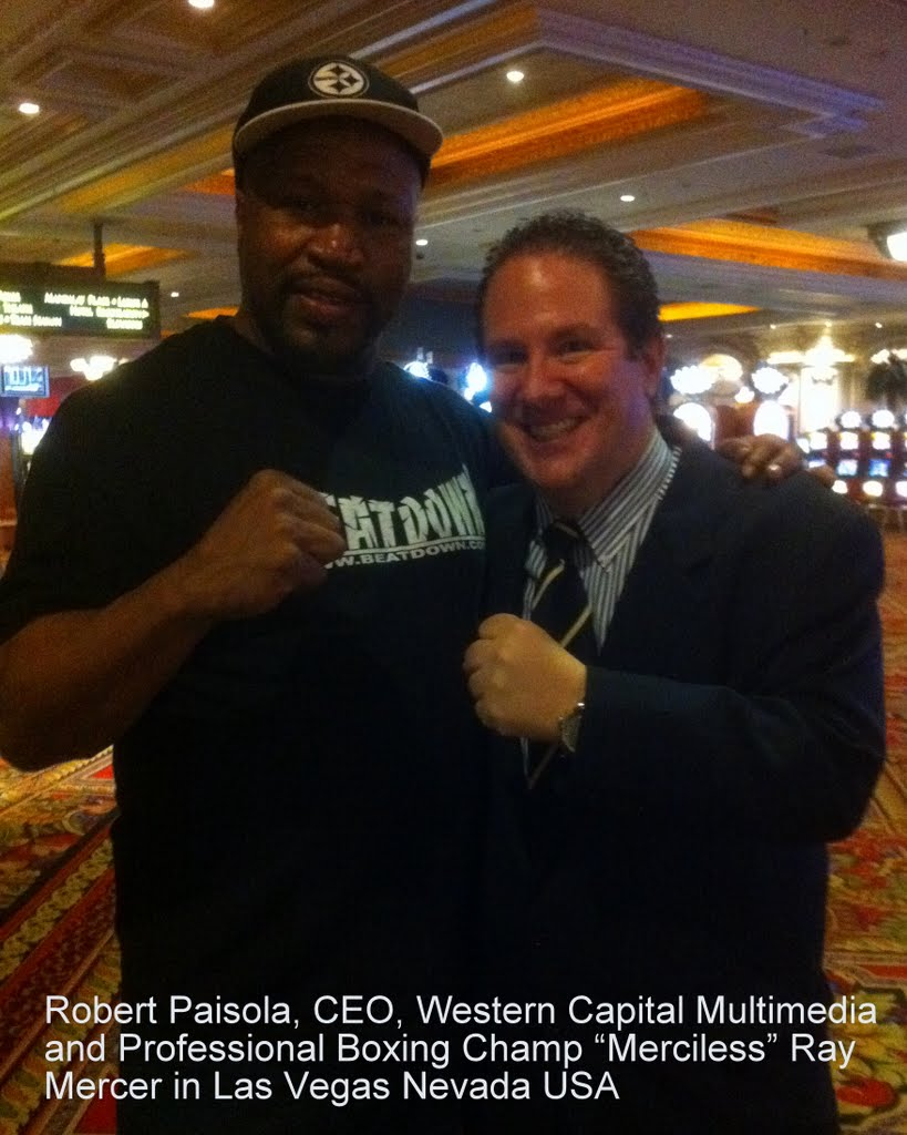 Robert Paisola, CEO of Western Capital Multimedia USA and Professional Boxer Merciless Ray Mercer  At Mandalay Bay Resort