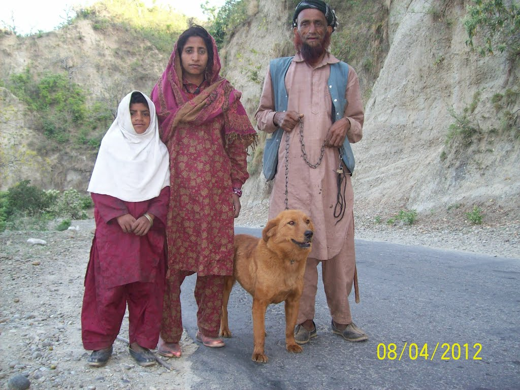 A Guzzar Family (Shepherd Tribe of India) migrating at onset of Summer from plains to Hills for pastures