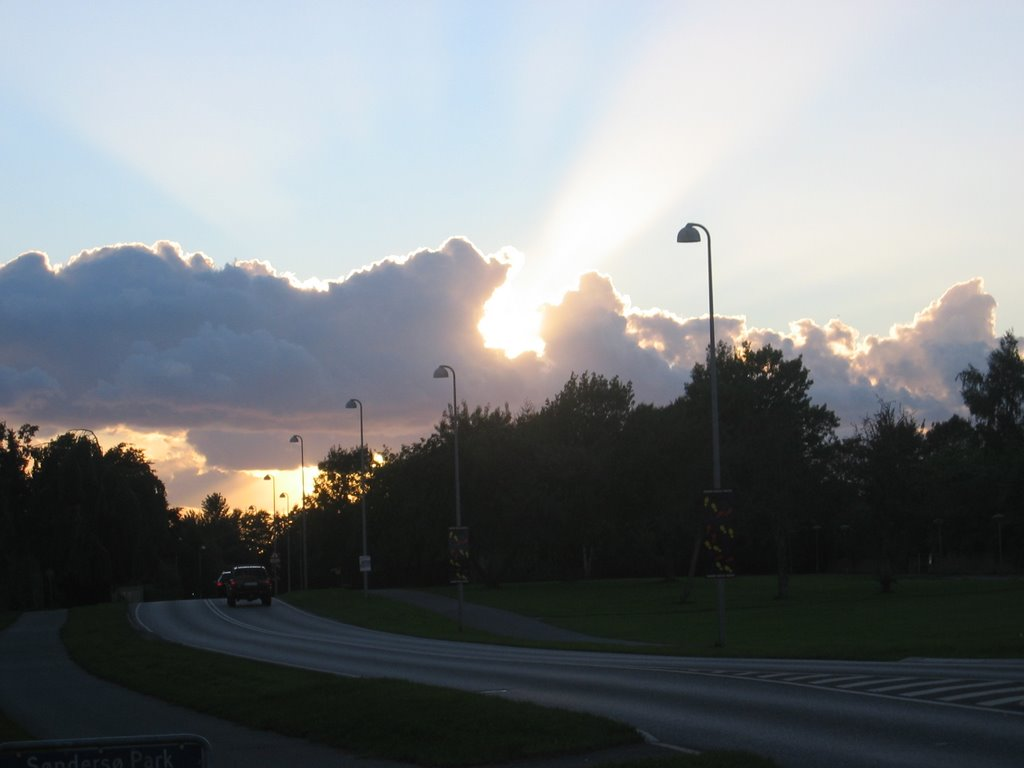 Sunset behind clouds